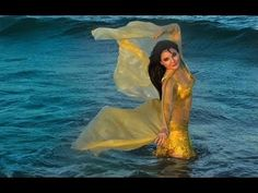 Tanna Valentine bellydancing in the ocean