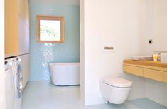 Turquoise tiles form a diagonal pattern across the walls and floor of this bathroom.