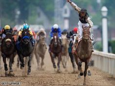 Calvin Borel atop Mind That Bird crosses the finish line to win the 135th running of the Kentucky Derby.