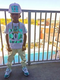 Waw! kidd got swag!! i want tht shirt n snapback he's wearin the shoes too