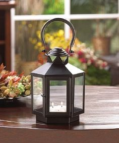 Hexagon Carriage Lantern - This compact candle lantern packs a lot of personality! Six clear glass panels are set in a black metal frame that's topped with an oversized hanging loop. Set the stage for pure candlelight to light your way. Black Candles, Tea Light Candles, Pillar Candles, Tea Lights, Hanging Lanterns, Candle Lanterns, Wooden Lanterns, Lanterns Decor, Lanterns