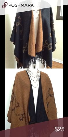 Large reversible shawl Everyone needs this versatile shawl in their wardrobe.  Get two in one with this reversible great earth toned shawl.  Dress it up or down. Jackets & Coats Capes
