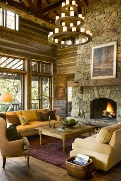 A stone fireplace and steel chandelier give a this home a ranch feel