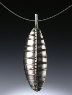 Necklace | Talya Baharal & Gene Gnida. 'Sheild pod'.  Sterling silver and bronze
