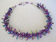 purple kumihimo (paddle shaped beads with seeds)