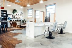 The unique Buffalo Co. exudes the laid back vibe of a barbershop while providing the service level of a high end salon. Our Dainty barber chairs strike the perfect balance in this blend of rustic and modern design. Barber Chair, Barber Shop, Buffalo, Salons, Modern Design, Rustic, Kitchen, Table, Chairs