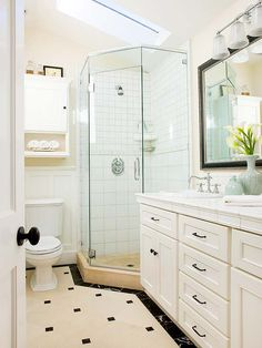 Playful patterned tile adds interest to this fresh white bath. Tour the rest of this home: http://www.bhg.com/home-improvement/remodeling/before-and-after/house-tour-renovate-restyle/?socsrc=bhgpin041913blackwhitetile=11