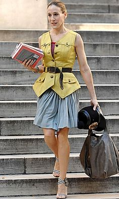 Sarah-Jessica Parker as Carrie Bradshaw in Sex and the City wearing Proenza Schouler yellow sleeveless jacket.