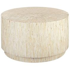 Elegant and modern, our mother-of-pearl coffee table is a stunning eye-catcher. Its sleek lines let the lustrous strips of mother of pearl shine. Place it anywhere you need a striking focal point.