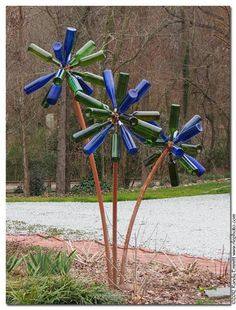 Wine bottle flowers .. weld lag bolts onto a steel ball then screw into bottle with a rubber stopper glued into it.