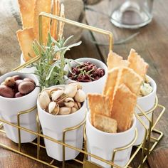 Serve tapas, antipasti or small appetizers in flower pots, via Hip Hostess