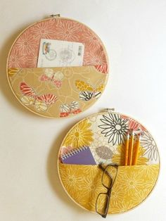 Colorful and patterned fabric in round wooden embroidery hoops turned into a pockets for organization.