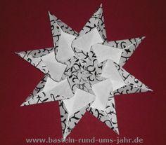 Drachenstern aus weiß silbernen Papier - eine Bastelarbeit für Kinder