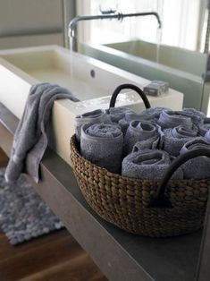 rolled peach and grey hand towels. When you're in a tiny apartment without a linen closet, you have to find alternative ways to store extra bath towels. Hand Towels Bathroom, Bathroom Storage, Bath Towel Storage, Zen Bathroom, Storage Mirror, Family Bathroom, Design Bathroom, Bath Design, Bathroom Interior