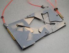 VA828  Street shifts neckpiece -Aluminium, stg silver, brass, cord, enamel paint  $480