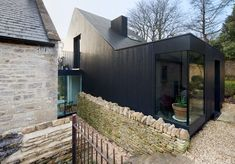 One of our favorite houses ever? London theater designer Niki Turner's Providence Chapel conversion in the picturesque village of Colerne near Bath. Stone Cladding, Timber Cladding, Exterior Cladding, Black Cladding, Chapel Conversion, Church Conversions, Architecture Extension, Architecture Design, Rural House