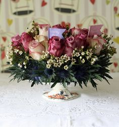 cake stand with vintage roses, thistles, and Alice & Wonderland Flags Tea Party Wedding, Wedding Fair, Table Arrangements, Floral Arrangements, Tea Party Centerpieces, Vintage Cake Stands, Afternoon Tea Parties, Vintage Roses, Wedding Inspiration