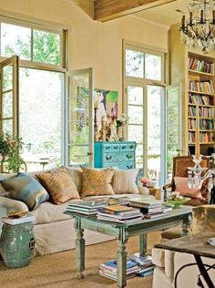 Blue and Neutral decor, relaxed; lots of light, sisal / seagrass rug, painted coffee table, bookshelves