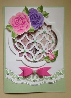 This 5x7 card features the Altenew Build-A-Rose stamps and dies included in issue 149 of Simply Cards and PaperCraft Magazine. Also used StampinUp Window Framelits and Lattice die, Spellbinder's Border Die and Cheery Lynn Bow Die. The little rosebud in the bottom corner is from StampinUp Wild Rose set. Card designed and created by Karen Margotta.