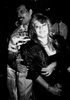 Freddie Mercury with Samantha Fox at Queen's afterparty in Kensington Roof Gardens, 1986.