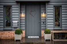 Detail of timber cladding, brick plinth and front door Front Door Lighting, Front Door Entrance, Glass Front Door, House Entrance, Front Door Decor, Cottage Front Doors, Front Porch, Modern Front Door, Front Door Design