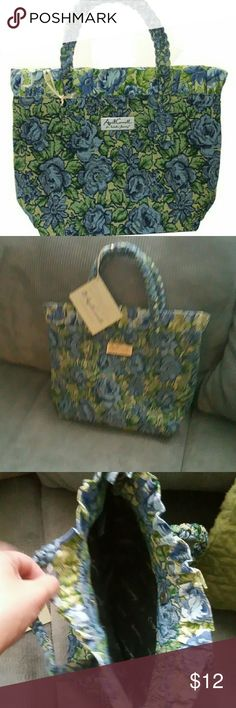 "April Cornell petite carpet bag This tapestry carpet was made by April Cornell for Isabella's Journey. It is in the ""Sunshine Petite"" pattern of blue, light yellow and green florals. The bag has a fabric lining, a small pocket and a larger zipper pocket. The closure is magnetic and the strap is braided tapestry fabric. Tags still on it! Bags Totes"