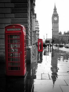 An iconic London scene- Big Ben, red telephone boxes & rain