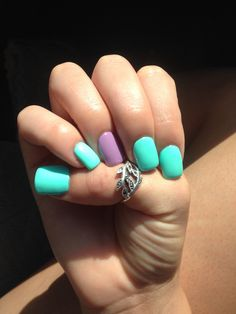 Bright turquoise and purple acrylic nails! Perfect for summer!