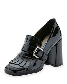 """Prada burnished patent leather loafer. 3.3"""" covered block heel. Round moc-stitched toe. Buckle strap with kiltie detail. Tonal topstitching. Leather lining. Slip-on style. Made in Italy."""