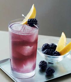 Down the Stretch --//        1 1/2 oz Vodka   /   1/2 oz Blue Curacoa    /  1 oz Lemon Lime soda     / 1 oz Sweet n Sour    /  1 oz Cranberry.  //  Add all ingredients to a tall glass filled with ice. Stir vigorously, and present with a fresh blackberry and a slice of lemon.