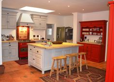 French Flair Kitchen in Fresh Linen (without the twirl) and Mexican red - Flair Wall Units, Custom made Center Island, and Coffee dresser.