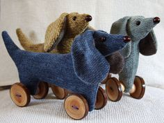 handmade vintage style dachshund / sausage dog / wiener / doxie on wooden button wheels / dark blue. $19.99, via Etsy.