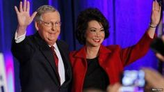 U.S. Senate Minority Leader Mitch McConnell (R-KY) waves to supporters with his wife, former United States Secretary of Labor Elaine Chao, at his midterm election night rally in Louisville