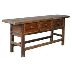 Reclaimed elm wood console.  Product: Console tableConstruction Material: Reclaimed elm woodColor: Antique naturalFeatures:  No top coat or sealant is applied, ensuring its patina to become enhanced over timeThree doors Dimensions: 33.5 H x 78 W x 20 DNote: Each table will differ slightly and measurements will vary
