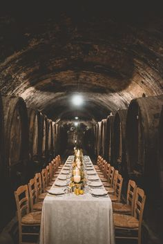 Candles are lit and a path is shown to their lovely dinner site – an ancient wine cellar full of great Chianti wine barrels.