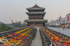 Bycicles for rent - Pinned by Mak Khalaf Bycicles for rent on which people can make a cycling tour around and on the city wall of Xian in China. Picture made during my trip from Amsterdam to Bangkok in 2014. Travel ChinaCity wallTravelXianbyciclescityold wallstreetstreet photography by pietvanderlaan