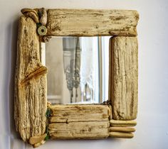 Beautiful, decorative mirror, beach cottage style, made of driftwood, seashells, sea glass, boat rope .... This lovely mirror will bring a warm, summer atmosphere into your home. Ideal gift for someone who has spent his life on the sea and wants to bring good old memories. This mirror would look great with a rustic style of decor, as well as a modern, clean environment that needs an earthy touch.