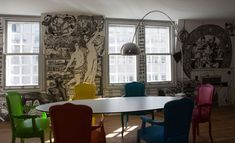 Definitely plan on including a mural in my apartment. I like all the different color chairs, too.