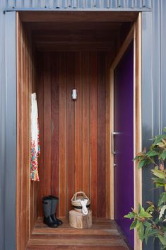Timber cladding to entry with purple front door!