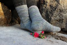 Simple yet stunning! These socks are easy to make, but eye-catching eyelets and twisted rib look nice in different colors. I worked my socks in amazing colorway Quiet Folly by The Uncommon Thread.