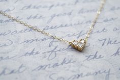 Our Gold Heart Necklace makes a wonderful bridesmaid gift. The dainty gold necklace will go beautifully with bridesmaid dresses.