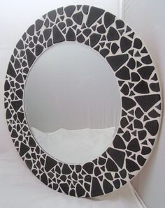 This beautiful mirror is hand made by myself to the highest quality. 'Turtle Grey' is made using porcelain mosaic tiles. The mirror in total measures approximately in diameter, the actual mirror measures in diameter. The mirror comes fitted.