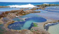 Waves crashing over the Figure Eight Pools rock shelf in Royal National Park. Photo: David Croft/OEH