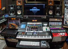 Close up on the custom desk of Scott Jacoby, a Grammy Award-winner Writer, Producer, Engineer, Mixer, Musician and Recording Artist. His desk is designed to make creativity move fast. Our iDock Air is neatly installed on the desk allowing his iPad Air to be safely stored and fully charged!! (Photo: Matt Dine)