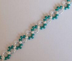 Items similar to Green Turquoise Seed Bead Cable Weave Chainmaille Anklet, DNA Strand Chainmaille Jewelry, Beaded Chainmail Anklet, Chain Mail Body Jewelry on Etsy Wire Jewelry Rings, Jump Ring Jewelry, Bead Jewellery, Wire Wrapped Jewelry, Jewelery, Body Jewelry, Diy Beaded Bracelets, Beaded Anklets, Diy Earrings