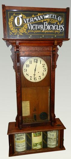 Sidney Advertising Clock c1886 ~ The bottom section of the Sidney clock has three revolving cylinders, each with four curved slots that hold advertising cards. Every 15 minutes a bell rings and the cards rotate one quarter turn, displaying a new ad.