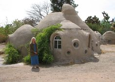 earth bag dome home - coil pot style construction with sand bags covered with adobe