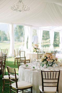 A tented wedding reception | @kateholstein | Brides.com