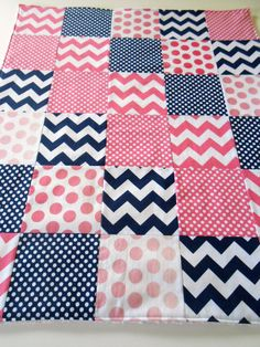 Chevrons and dots minky backed baby patchwork sewn as a custom order for a navy blue and hot pink themed nursery. Love the colors and Riley Blake's ombre dots so much that I have listed it as a made to order item in my shop. It is lined with a layer of Warm & Natural cotton batting and has blush pink Shannon Fabrics' dimple dot minky on the back. In my shop now.