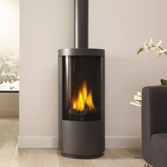 Drugasar Circo An elegant freestanding gas stove with desirable curves. Standing over 1 metre high, the Circo freestanding gas fire has a large viewing window that reveals a classic log fire with high, dramatic flames and generous warmth. Small Gas Fireplace, Gas Stove Fireplace, Freestanding Fireplace, Fireplace Inserts, Modern Fireplace, Fireplace Design, Freestanding Stoves, Freestanding Wall, Fireplace Blower